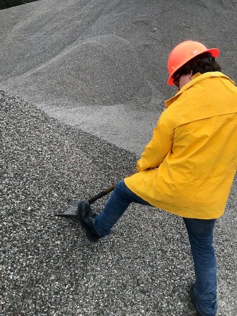 Pulling a sample from a pile of stone