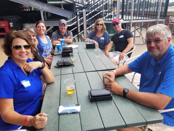 Table of people at Tincaps game