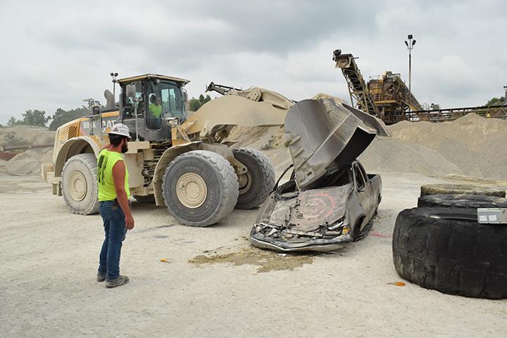Loader vehicle crushes pickup truck.